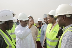 Hon. Minister asking questions during the site tour