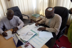 Engr. Timothy and Prof. Ibrahim (V.C) signing the Site Handover Form