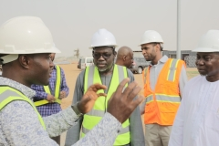 The REA Resident Engineer Responding to the Hon.Minister's questions during the Site Tour