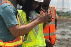 UNILAG-A student being taught how to take aerial shots of the site with a drone.