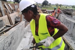 FUAM SITE - STEM FEMALE STUDENT PARTICIPATING IN THE DISMANTLING OF THE FORMWORK STRUCTURE OF A CASTED OUTDOOR CABLE TRENCH FOUNDATION WALL