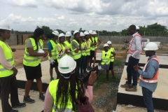 STEM students receiving safety briefing at the project site from METKA representatives