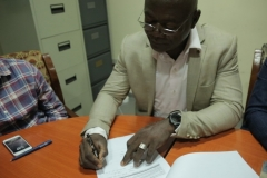 Engr. Timothy Signing the Site Handover Form