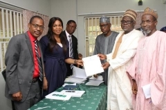 MD-CEO, REA with university representatives at the MoU Signing Ceremony