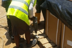 Awka-Site-STEM-student-assisting-in-the-drilling-of-workpiece