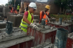 FUAM-SITE-A-STUDENT-ACTIVILY-WORKING-WITH-THE-STREET-LIGHT-CONSTUCTION-TEAM-DURING-THE-CASTING-OF-THE-PEDESTALS