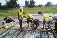 FUAM-SITE-STEM-FEMALE-STUDENT-TAKING-PART-IN-THE-ONGOING-CASTING-OF-THE-CABLE-TRENCH-FOUNDATION-PRE-CAST-SLAB