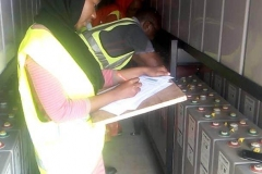 BUK-STEM-students-their-supervisor-measuring-and-recording-battery-voltage
