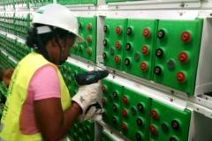 FUNAI-STEM-student-assisting-to-screw-battery-terminals-at-BBR